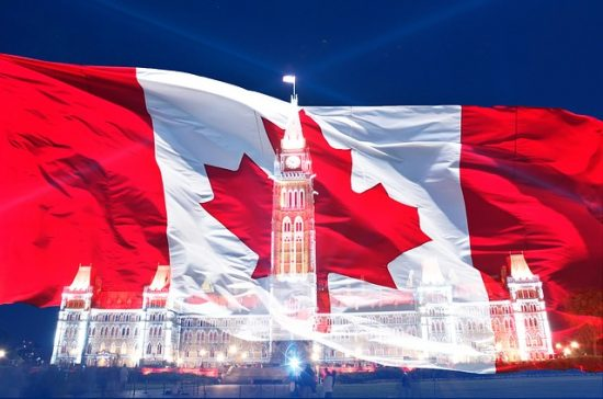 Canadian flag with silhouette of Parliament Buildings. Happy Canada Day!