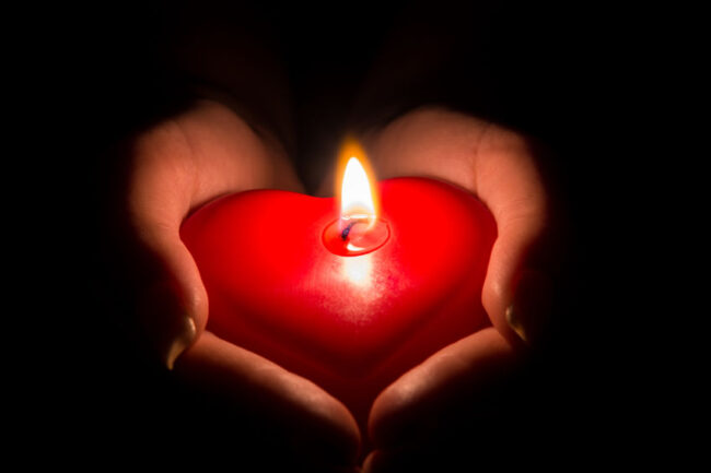 Giving-back-red-heart-candle